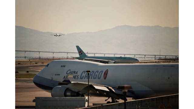 Woman charged after running on San Francisco airport cargo tarmac