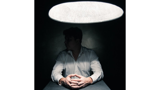 bigstock Man in a dark room illuminated 82057358 5566117907a8c