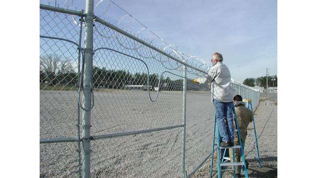 integrator-installing-on-fence_10884617.psd