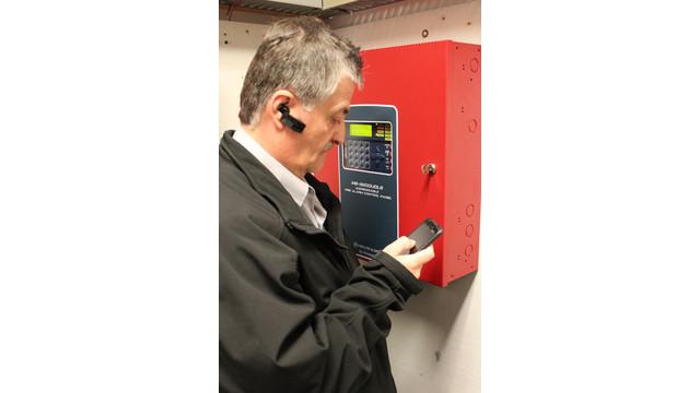 Installer-w-mobile-phone-panel-