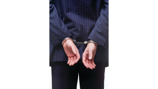 bigstock-businessman-in-handcu_10946367.psd