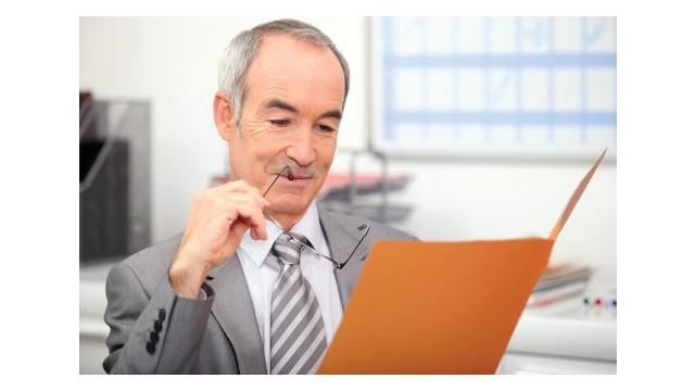 bigstock-recruiter-reading-job_11239018.psd